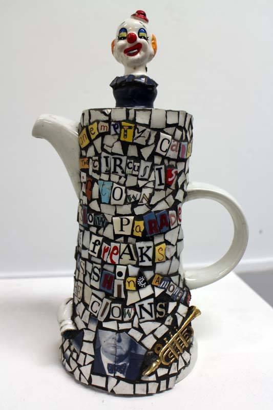 A teapot made out of words and LOVE.